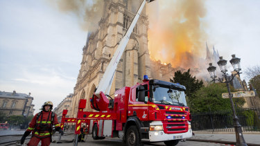 Fire fighters working at the burning Notre-Dame cathedral.