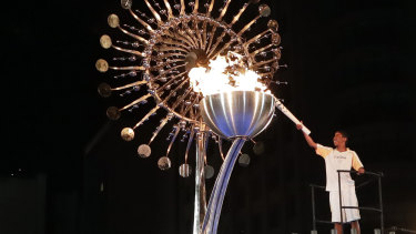The flame is lit at the opening ceremony of the 2016 Rio de Janerio Olympics. The Queensland Opposition is backing a Brisbane bid.