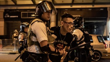 A protester is detained by police outside of Po Lam Station in Hong Kong on September 5.