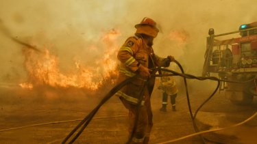 Spot fires threaten to overwhelm RFS volunteer firefighters on the NSW Mid North Coast.