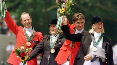 Andrew Hoy, Wendy Schaeffer, Phillip Dutton and Gillian Rolton celebrate their gold medal win at the 1996 Olympics.