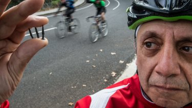 George Mihailides pictured back in 2015 with tacks found on Yarra Boulevard.