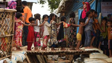 Rohingya children queue for vaccinations at a UNICEF nutrition centre in a refugee camp.