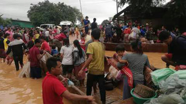 Rescue efforts are ongoing in villages flooded after part of a newly built hydroelectric dam was breached in southeastern Laos.