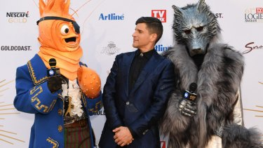 Host Osher Gunsberg (centre) and characters from the The Masked Singer.