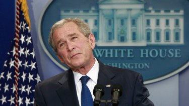 George W Bush pauses during his final press conference in 2009.