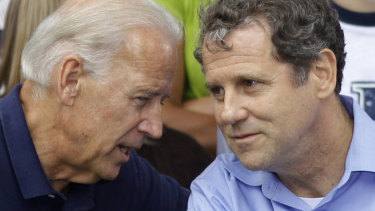Then Vice President Joe Biden, left, speaks with Senator Sherrod Brown at union Labor Day picnic in Ohio in 2011.
