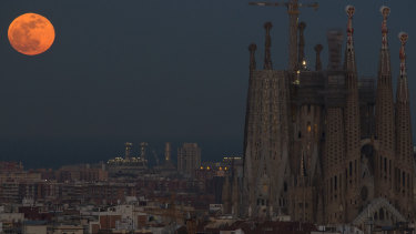 Barcelona's Sagrada Familia Basilica is backdropped by a super blood moon in January 2018.