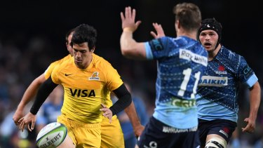 Cheeky: Matias Moroni of the Jaguares chips the ball over Cameron Clark before scoring.