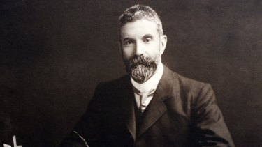 Alfred Deakin at his desk.