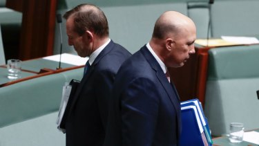 Liberal MPs Tony Abbott and Peter Dutton depart after Question Time at Parliament House on August 21.