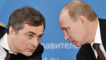 Russian Prime Minister Vladimir Putin, right, speaks to Vladislav Surkov, credited with converting Russian public life into a huge guessing game.