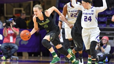 WNBA-drafted talent Kristy Wallace has signed with the Canberra Capitals.