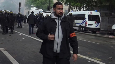 Wearing a police patch, French presidential security chief Alexandre Benalla patrols during clashes with activists on the sidelines of the  traditional May Day rally, in Paris.