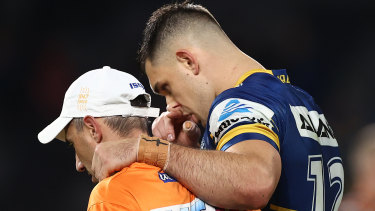 Ryan Matterson is helped off the field after a first-half concussion against the Tigers on Thursday night.