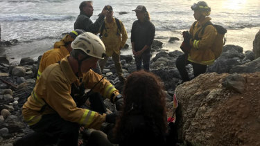 Authorities tend to Angela Hernandez after she was rescued, in Morro Bay, California.