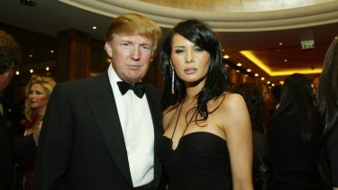 Donald Trump and then partner Melania Knauss attend a charity event in 2004.