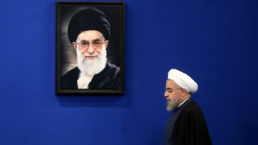 Iranian President Hassan Rouhani was elected after economic unrest in 2013 unnerved Supreme Leader Ali Khamenei (in the portrait).