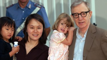 Woody Allen with wife Soon Yi and adopted daughters Bechet and Manzie at the Venice Film Festival in 2003.