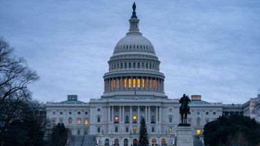 The US Capitol is seen under early morning gray skies in Washington.