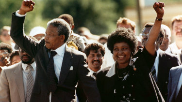Nelson Mandela and Winnie raising their clenched fists upon his release from prison in 1990.