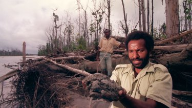 Alex Maun, a landowner who sued BHP in the 1990s, in the dying forest near the Ok Tedi River.