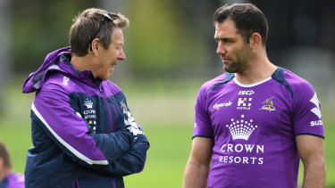 Storm coach Craig Bellamy talks tactics with captain Cameron Smith.
