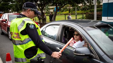 Police check cars for permits at a checkpoint in Coolangatta as the Queensland border re-opened to most other states on July 10.