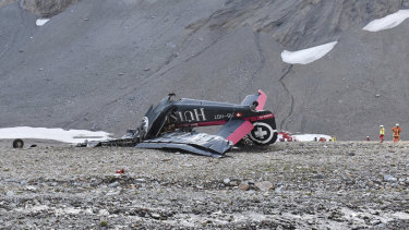 The wreckage of the old-time propeller plane Ju 52  after it crashed in Switzerland.