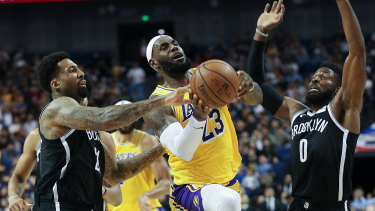 Lakers superstar LeBron James drives to the basket against the Nets.