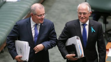 Prime Minister Scott Morrison and  Malcolm Turnbull in Parliament