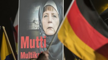 Angela Merkel hobbled by internal politics.