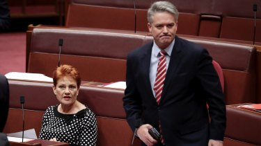 Senators Pauline Hanson and Finance Minister Mathias Cormann.