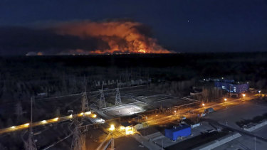 A forest fire is seen burning inside the exclusion zone around Ukraine's Chernobyl nuclear power plant, foreground, last week.
