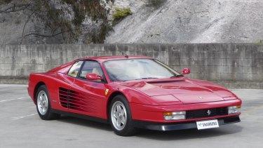 A 1985 Ferrari Testarossa coupe.