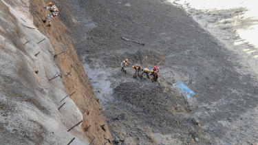 Officials said the glacier breaking sent water as well as mud and other debris surging down the mountain.