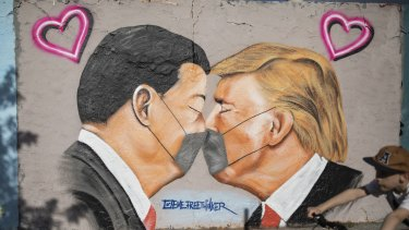 Graffiti in Berlin showing the face-off between Chinese President Xi Jinping and US President Donald Trump.