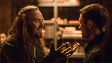 Tim Minchin, left, as Tuck and Taron Egerton, right, in Robin Hood.