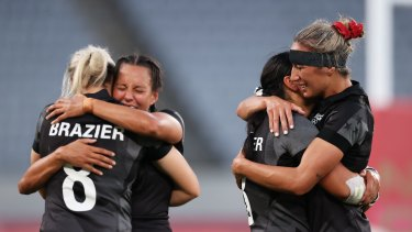 New Zealand celebrate after defeating France to win gold in rugby sevens.