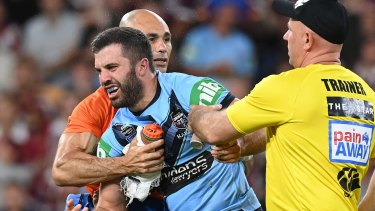 James Tedesco is helped from the field on Wednesday night.