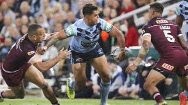 Not his day:  Latrell Mitchell of the Blues.