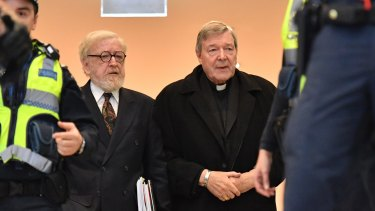 Robert Richter, QC, arrives at Melbourne Magistrates Court with George Pell in July 2017.