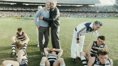 Fred Wooller consoles Geelong coach Malcolm Blight after their 1989 grand final loss.  Players, from left: Flanigan, Stoneham, Bews, Bairstow and Couch.