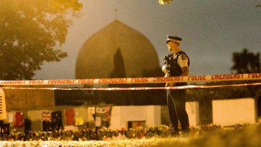 A policeman stands guard at the Al Noor Mosque ahead of a national call to prayer after the shootings.