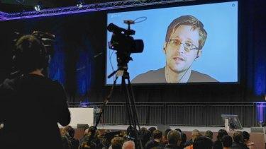 American whistleblower Edward Snowden delivers a talk via video.