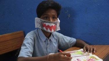 An Indian students wears a self-made mask to school in Hyderabad, India.