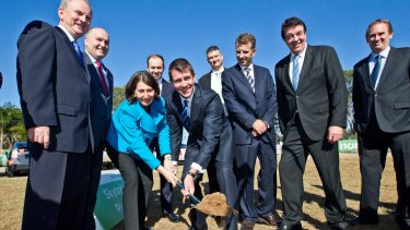 Ground breaking: then premier Mike Baird and transport minister Gladys Berejiklian turn the first sod at the Kellyville Station for the Northwest Rail Link in 2014.