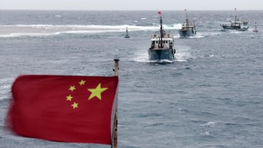 Chinese fishing boats sail near Meiji reef off the island province of Hainan in 2012 in a part of the South China Sea that is also claimed by Vietnam. China has territorial disputes in the South China Sea with several nations.