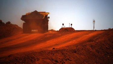 A Fortescue Metals Group autonomous haul truck loaded with iron ore in the Pilbara.