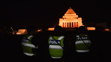 Police observe Anzac Day dawn service at the Shrine of Remembrance, Melbourne.